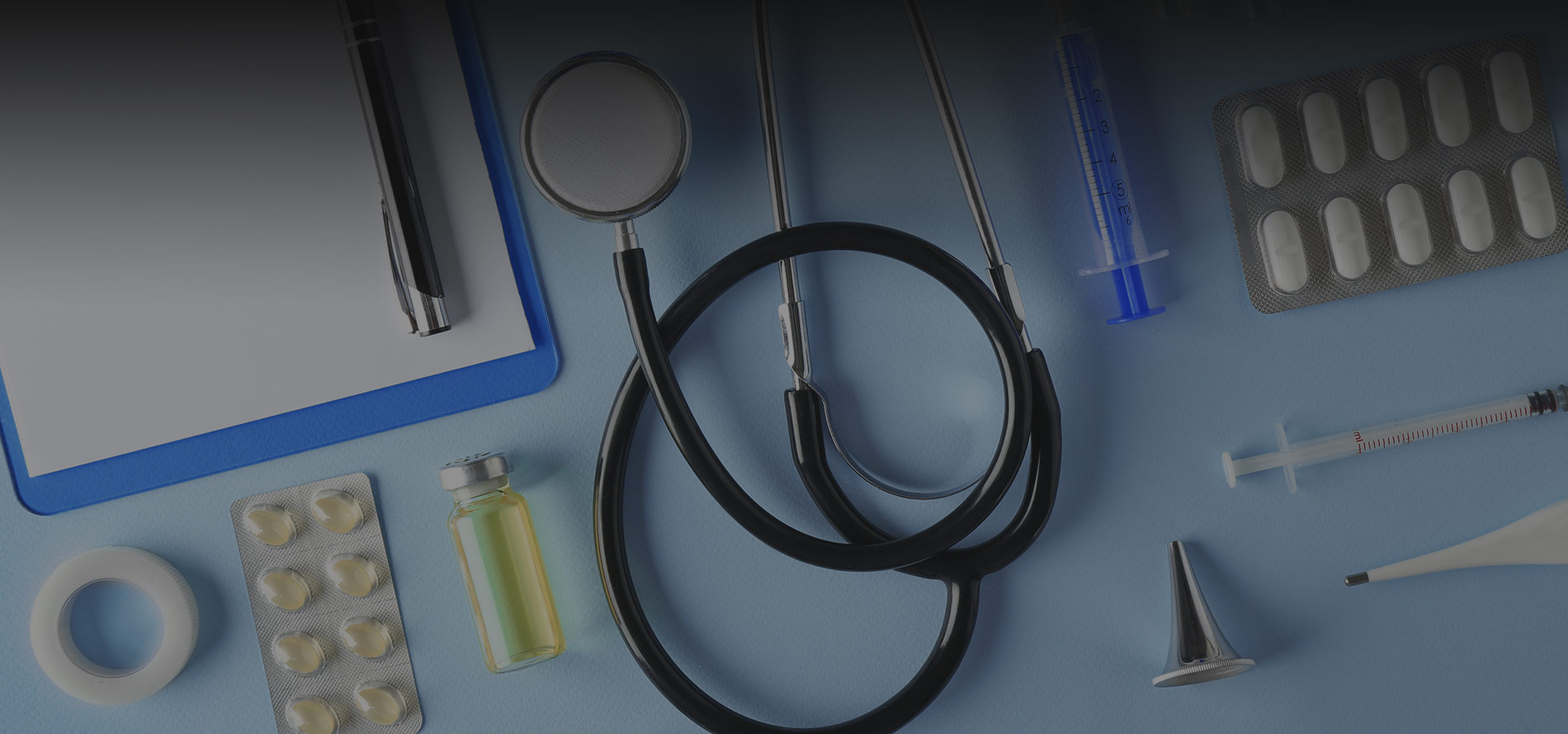 a stethoscope, pills and vials- a medical assistant's tools